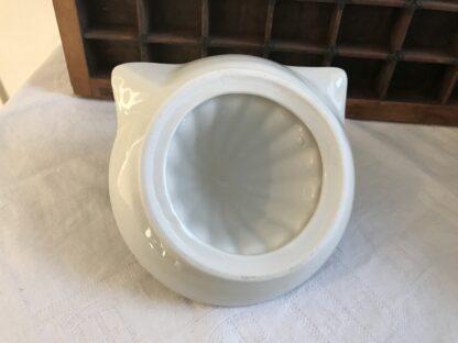 Witte aardewerken citrus pers kattenkop